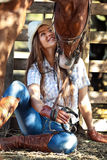 Cowgirl with horse. Young cowgirl with horse kissing her Stock Images