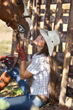 Cowgirl with horse. Young cowgirl with horse kissing her Stock Photos