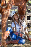 Cowgirl with horse. Young cowgirl with horse kissing her Royalty Free Stock Images