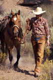 Cowgirl and Horse. Cowgirl in the desert with her horse stock image