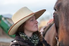 Cowgirl and a horse. Close up of a cowgirl and a brown horse Stock Images