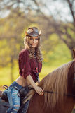 Cowgirl and Horse. Retro Style Royalty Free Stock Images