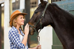 Cowgirl horse stable Stock Images
