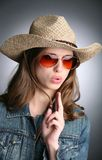 Cowgirl with imaginative gun Stock Photo