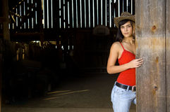 Free Cowgirl In Barn Doorway Royalty Free Stock Photography - 14249797