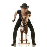 Cowgirl (jockey) race on hobbyhorse Royalty Free Stock Photo