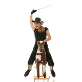 Cowgirl (jockey) race on hobbyhorse Stock Photo