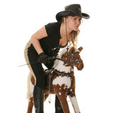Cowgirl (jockey) race on hobbyhorse Royalty Free Stock Images