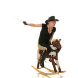 Cowgirl (jockey) race on hobbyhorse Royalty Free Stock Photography