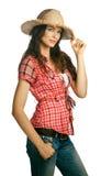 Cowgirl joven hermoso que desgasta un sombrero Fotografía de archivo