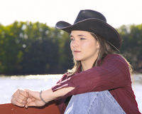 Cowgirl by lake Royalty Free Stock Photo