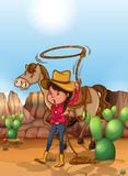 Cowgirl with lasso in desert  Royalty Free Stock Photography