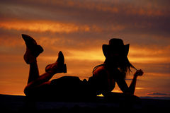 Cowgirl lay stomach silhouette Stock Photo
