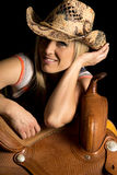 Cowgirl lean on saddle hat on smile Royalty Free Stock Photography