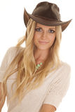Cowgirl light shirt close look slight smile Stock Photography