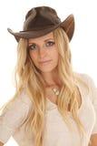 Cowgirl light shirt close slight smile Stock Photo