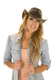 Cowgirl with long blond hair hold shirt look stock image