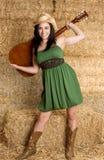 Cowgirl mit Gitarre Stockfoto