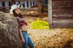 Cowgirl model posing on farm Stock Images