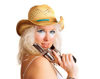Cowgirl with modern makeup and gun Stock Image