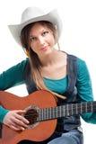 Cowgirl no ahat com guitarra acústica Fotografia de Stock Royalty Free