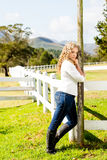 Cowgirl at the picket fence Stock Photography