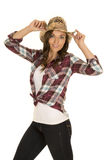 Cowgirl in plaid shirt and hat touch look forward Stock Image