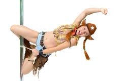 Cowgirl on a pole. Young woman in cowboy suite hanging on a pole Stock Photography