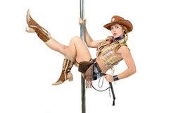 Cowgirl on a pole. Young woman in cowboy suite hanging on a pole Royalty Free Stock Photography