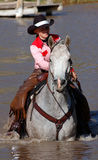 Cowgirl in Pond. Cowgirl on gray horse in pond - vertical royalty free stock photos