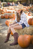 Cowgirl Portrait at the Pumpkin Patch Stock Photos