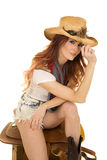Cowgirl with red hair sit on saddle smile Royalty Free Stock Photo