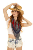 Cowgirl with red hair stand hold hat Royalty Free Stock Photos