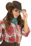 Cowgirl red plaid shirt smile touch hat Royalty Free Stock Photography