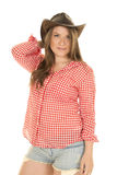 Cowgirl red white shirt hat on head Stock Photo