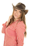 Cowgirl red white shirt hat side small smile Royalty Free Stock Photo