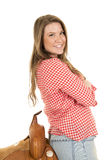 Cowgirl red white shirt saddle lean back Royalty Free Stock Images
