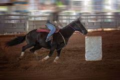 Cowgirl Rides Horse At Speed In Rodeo Barrel Racing Competition Royalty Free Stock Photography