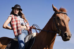 Cowgirl riding a bay horse Royalty Free Stock Images