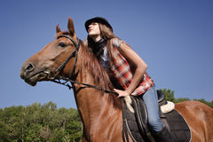 Cowgirl riding a bay horse Royalty Free Stock Photos