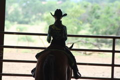 Cowgirl riding at horse show Royalty Free Stock Photos
