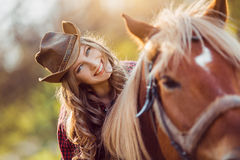 Cowgirl riding horse on summer field Royalty Free Stock Photography