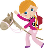 Cowgirl riding a stick, puppet horse. Little girl pretending to ride a real horse on the puppet horse Royalty Free Stock Photography