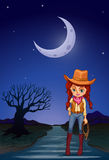 A cowgirl at the road in the middle of the night Royalty Free Stock Photo