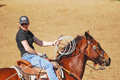Cowgirl Roping a Calf Royalty Free Stock Photos