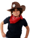 Cowgirl Sheriff at Work. Elementary child playing cowgirl-sheriff, trying to look tough while planning to draw her weapons royalty free stock photos