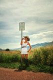 Cowgirl on a side of a road Stock Photos
