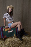 Cowgirl sitting on bail Royalty Free Stock Images