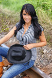 Cowgirl sitting on the railroad royalty free stock images