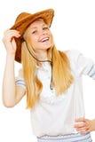 Cowgirl sonriente bonito en sombrero y la blusa blanca Fotografía de archivo